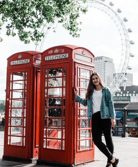 Eryn standing next to a London red telephone