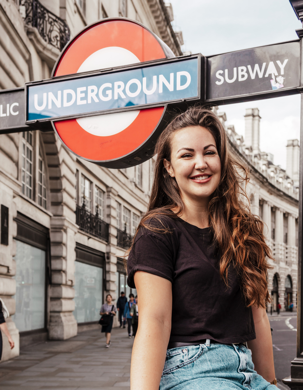 Eryn Peters sitting by London's Underground